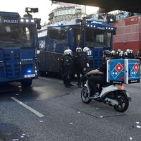 This Dominos delivery man was determined not to be stopped from doing his job by G20 riots in Germany