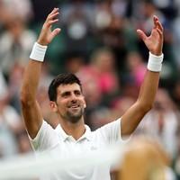 Djokovic survives injury scare to reach Wimbledon quarters
