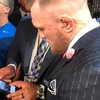 Conor McGregor wore a suit with 'f**k you' pinstripes at the Mayweather press conference