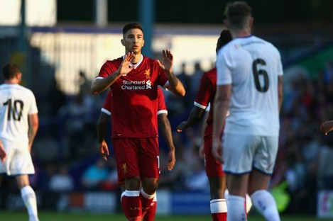 Marko Grujic celebrates a goal against Tranmere Rovers