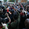 'Arrest someone': Anger simmers as hundreds hold vigil for Grenfell victims
