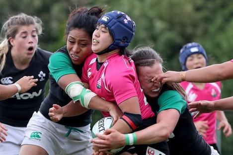 Sene Naoupu and Claire McLoughlin tackle Minor Yamamoto of Japan.