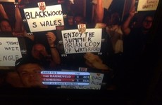 A Waterford fan held up a great sign ripping Kilkenny on TV at a darts event in Las Vegas