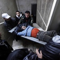 """""""They tied a detonator to my hand"""": Stories from inside Syria"""