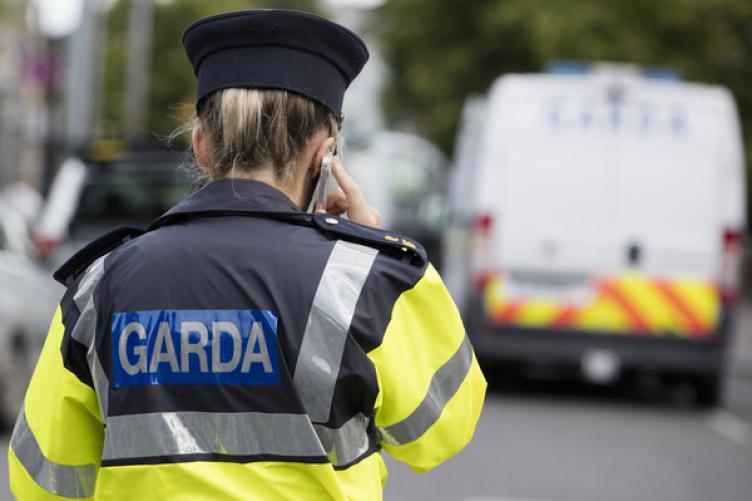 Garda at scene of murder.