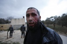 Over a dozen dead as shelling of Syrian city of Homs continues