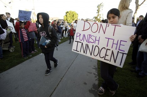 A student holding a sign outside the Miramonte Elementary School earlier today