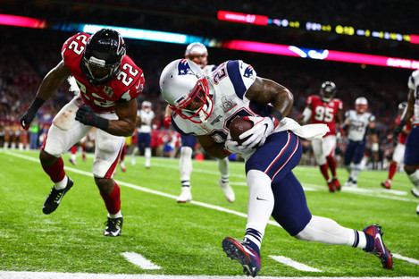 New England Patriots running back James White (28) is hit by Atlanta Falcons strong safety Keanu Neal (22) during Super Bowl LI.