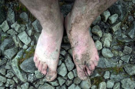 A barefoot pilgrim during the climb of Croagh Patrick.