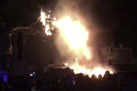 The fire quickly engulfed the main stage