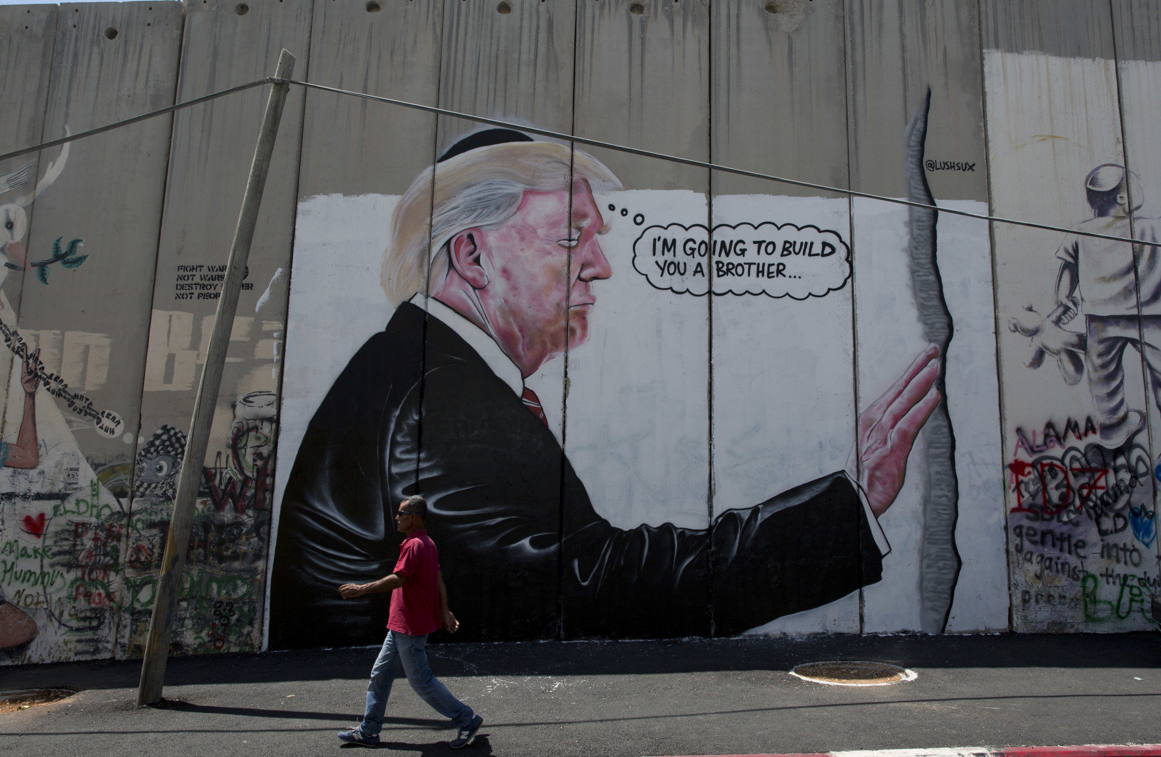 Wall Mural Posters Two Huge Banksy Like Trump Murals Appear On West Bank