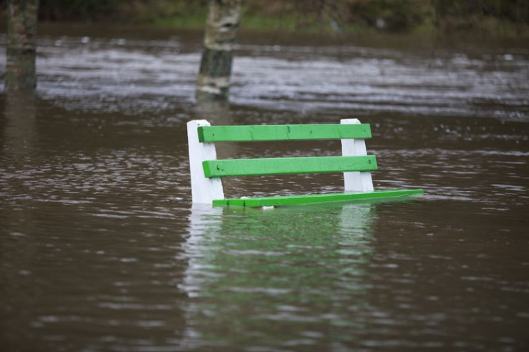 A park bench under water during flooding at Inistioge in County Kilkenny in 2015