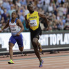 Usain Bolt pipped in photo finish, but is safely through to tonight's 100m final