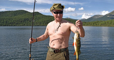 Putin cultivates strongman persona with holiday adventure snaps shown on Russian TV