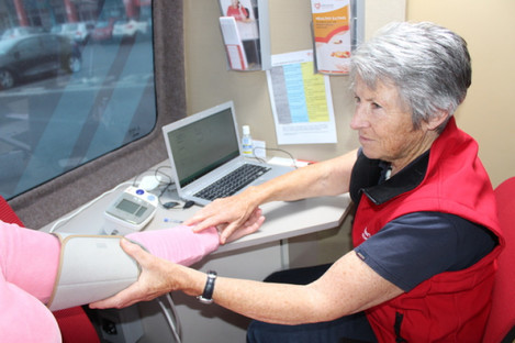 Nurse Carol Pye testing a patient's blood pressure in the Irish Heart Foundation's mobile health unit