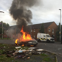 Police attacked in Belfast after removal of wood from nationalist bonfire site