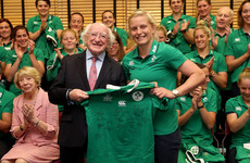Snap happy! President Michael D Higgins presents the Ireland side with their jerseys