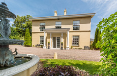 This beautifully restored Cork home comes with its own bar and horse stables