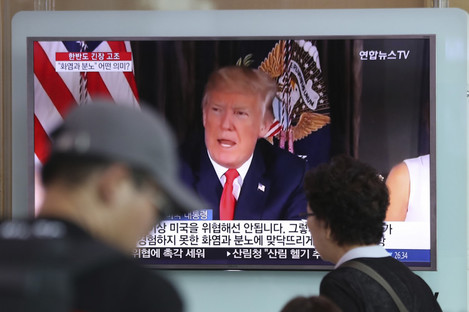 Donald Trump is seen on a TV in Seoul.
