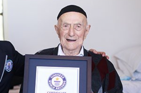 Yisrael Kristal receives his certificate last year for being the world's oldest man.