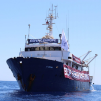 Stranded anti-migrant ship refuses help from migrant rescue vessel