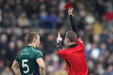 Kildare's Brian Flanagan is sent off by referee Joe McQuillan