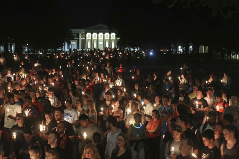 Students, teaching staff and Charlottesville residents led a candlelit march across the campus of the University of Virginia.