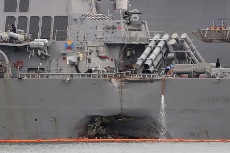 The damaged hull of the US Navy destroyer
