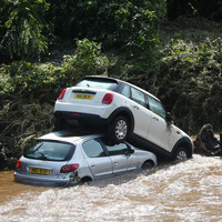 Pictures: Chaos on north-west roads after month's worth of rain falls in just a few hours