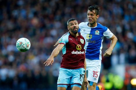 Blackburn's Elliott Ward in action with Burnley's Jonathan Walters (left).