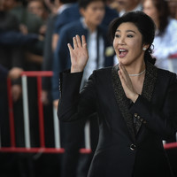 Former Thai PM 'dodges court and flees country' as she faces 10 years in prison