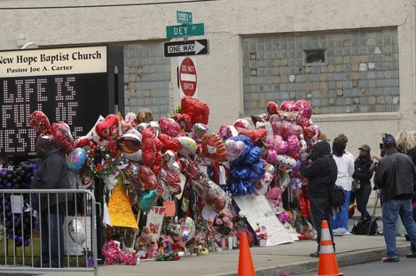 Fans at a memorial outside the New Jersey church where Whitney Houston's funeral will be held on Saturday