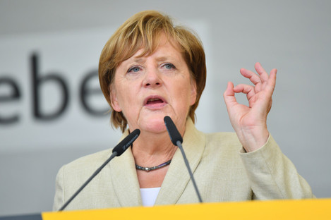 While polls show Merkel in the lead, almost 50% of voters say they are still undecided