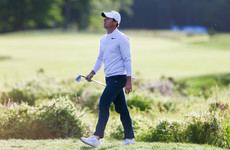Johnson on the money as McIlroy drops back after edgy start to title defence