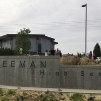 One killed and three injured at high school shooting in tiny US town