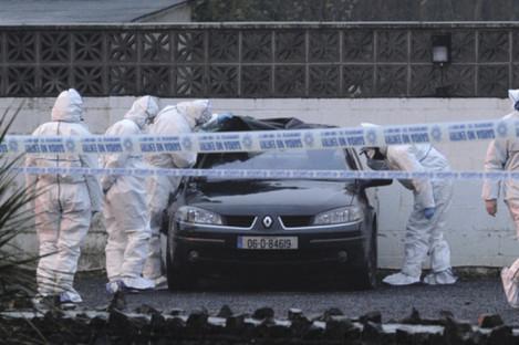 Gardai examine a car in the wake of the 2013 shooting at the Huntsman Inn.