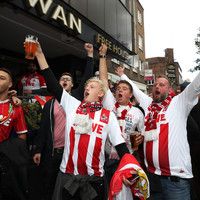 Thousands of FC Koln fans march through the streets of London ahead of Europa League tie