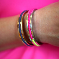 This bracelet ingeniously solves the problem of wearing a hair bobble on your wrist