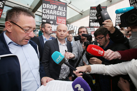 Protestors, including TD Paul Murphy, outside court after their acquittal in June.
