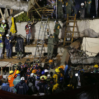 Mexican rescuers race to free girl trapped under school rubble
