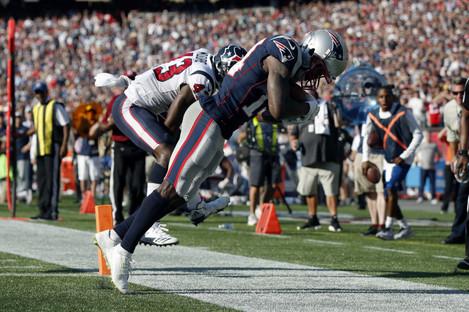 Brandin Cooks after receiving a perfect touchdown pass from Tom Brady.