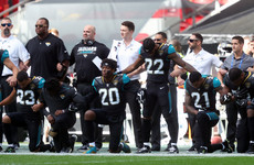Here's how everyone's reacting to 200 NFL players protesting in defiance of Donald Trump