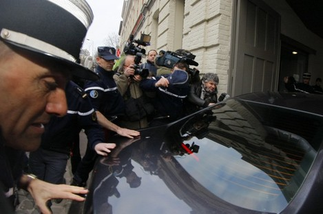 Dominique Strauss-Kahn arrives by car at a police station in Lille today