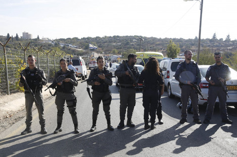 Israeli police block the road to Har Adar settlement near Jerusalem