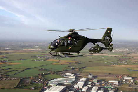 Two of the new Air Corps EC135 Light Utility Helicopters flying above Baldonnel Aerodrome, Dublin.