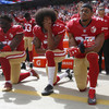 Explainer: Why are NFL players kneeling? And how did Trump get involved?