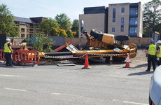 Safety concerns raised as construction vehicle topples over beside school grounds