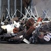 Libyan embassy hands over cache of guns and explosives