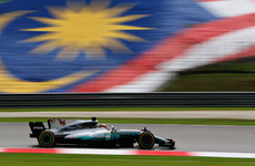 Hamilton claims pole in Malaysian GP, luckless Vettel to start from back of grid