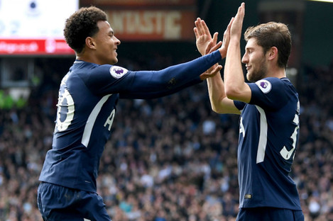 Dele Alli and Ben Davies celebrate the latter's goal at Huddersfield Town